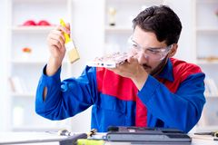 Repairman working in technical support fixing computer laptop tr Royalty Free Stock Photo