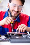 Repairman working in technical support fixing computer laptop tr Royalty Free Stock Photos