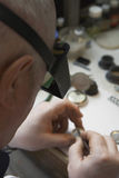Repairman Working On Watch In Workshop Stock Photos