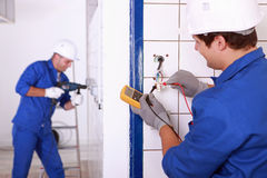 Repairmen in action royalty free stock photography