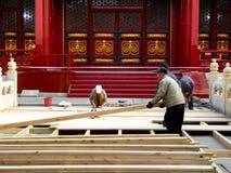 Repairmen repairing Biyong Temple road Royalty Free Stock Images