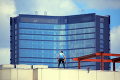 Repairment worker at rooftop Royalty Free Stock Photo