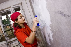 Repairs in the apartment. Female make repairs in the apartment royalty free stock photos