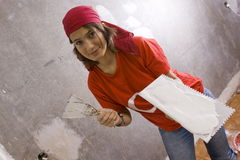 Repairs in the apartment. Female make repairs in the apartment royalty free stock image