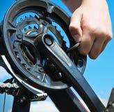 Repairs bicycle Stock Photos