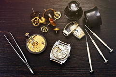 Repairs of old mechanical watches Royalty Free Stock Photo