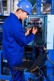 Reparação do coordenador industrial Imagens de Stock