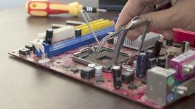 Reparación de la placa madre del ordenador Foto de archivo