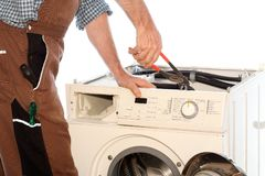 Reparación de una lavadora de la falta Imagen de archivo