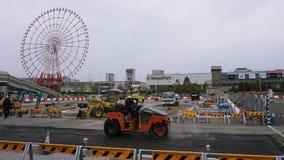 Reparación del camino en Odaiba, construcción de edificios foto de archivo libre de regalías