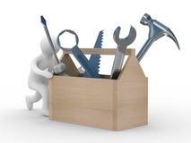Reparador com a ferramenta em um fundo branco. Fotografia de Stock