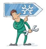 Reparador With uma chave que está em um sinal da oficina Imagem de Stock