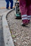 Reparando o asfalto Imagem de Stock