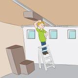 Reparando a porta da garagem Fotografia de Stock Royalty Free