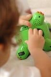 Reparando um brinquedo Fotografia de Stock Royalty Free