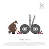 Reparatie en onderhoud van vliegtuigen De werktuigkundige zet een wiel CH stock illustratie