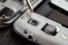 Reparatie van celtelefoon en andere gadgets Royalty-vrije Stock Afbeeldingen