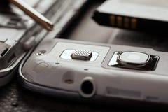Reparatie van celtelefoon en andere gadgets Stock Foto