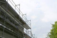 Reparatie van het gebouw, de bouwwerf en de steiger Royalty-vrije Stock Afbeeldingen