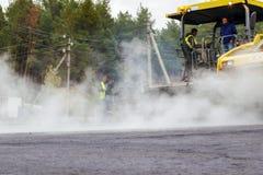 Reparatie van wegen in de stad Stock Foto