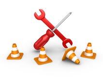 Reparatiehulpmiddelen achter verkeerskegels Stock Afbeelding