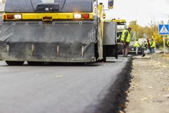 Reparation av vägar i staden Arkivbild
