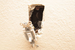 Reparation för ljus strömbrytare Fotografering för Bildbyråer