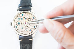 Reparation and restoration of watches. Details of watches and mechanisms for reparation, restoration and maintenance Royalty Free Stock Photo