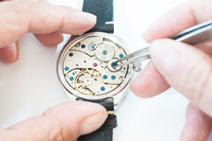 Reparation and restoration of watches. Details of watches and mechanisms for reparation, restoration and maintenance Stock Photography