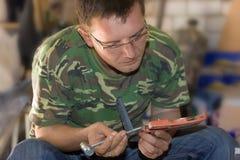 Reparatur in der Werkstatt Lizenzfreie Stockfotografie