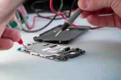 Repare el multímetro del smartphone Fotografía de archivo libre de regalías