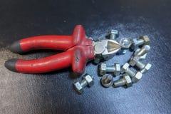 Repare las llaves, los tornillos y los alicates Foto de archivo