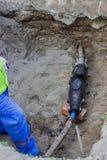 Reparera den underjordiska kraftledningen, reparation 2 för kabelskidan royaltyfri fotografi