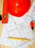 Reparieren Sie Arbeit Zeichnungen für das Errichten, Sturzhelm Lizenzfreies Stockfoto