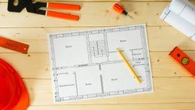 Reparieren Sie Arbeit Zeichnungen für das Errichten, Sturzhelm Lizenzfreie Stockfotos