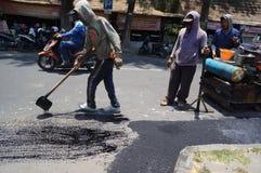 Reparing demage roads Royalty Free Stock Photo