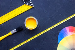 Reparing home concept. Paint and tools on black stone desk background top view copyspace.  royalty free stock photo