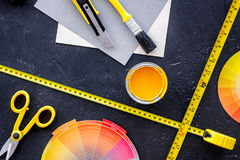 Reparing home concept. Paint and tools on black stone desk background top view copyspace.  royalty free stock image