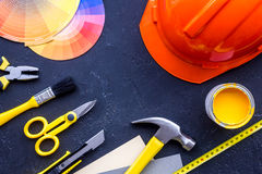 Reparing home concept. Paint and tools on black stone desk background top view copyspace. Reparing home concept. Paint and tools on black stone desk background stock photo