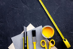 Reparing home concept. Paint and tools on black stone desk background top view copyspace.  royalty free stock photography