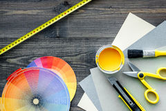 Reparing home concept. Paint and tools on wooden desk background top view. Preraring for repair. Paint and tools on wooden desk background top view stock image