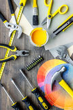 Reparing home concept. Paint and tools on wooden desk background top view. Preraring for repair. Paint and tools on wooden desk background top view stock photo