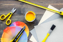 Reparing home concept. Paint and tools on wooden desk background top view. Preraring for repair. Paint and tools on wooden desk background top view royalty free stock photography
