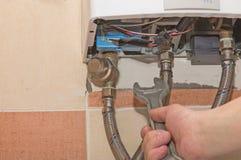 Reparo do aquecedor de água do gás Imagem de Stock Royalty Free