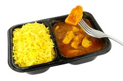Repas de commodité de micro-onde de cari et de riz de poulet Image stock