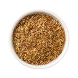 Repas de graine de lin dans une cuvette Photos stock