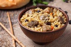 Repas gastronomique asiatique traditionnel appelé le pilaf cuit images libres de droits