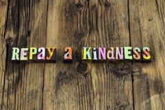 Repay kindness help gratitude grateful charity karma. Letterpress letters kind be nice gentle honest faith love pay gift forward stock image