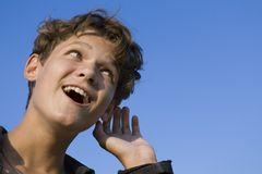 Repeat, I have not understood. Portrait of the young person on background blue sky Royalty Free Stock Photo