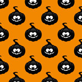 Repeatable pattern with black pumpkin over orange background Stock Photo